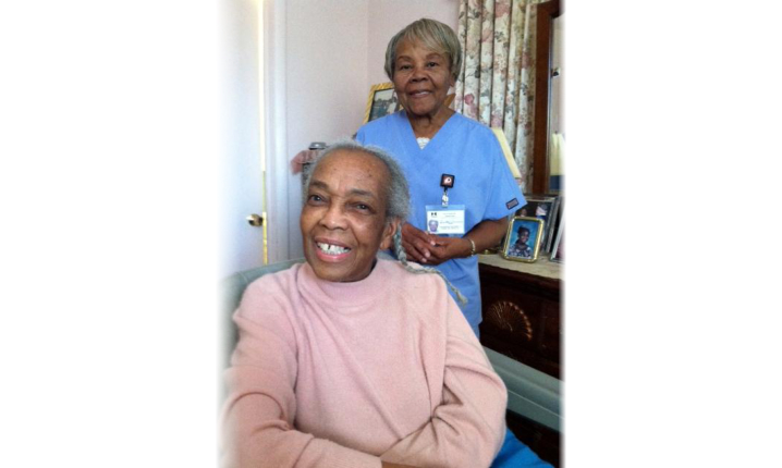 caregiver combing senior woman